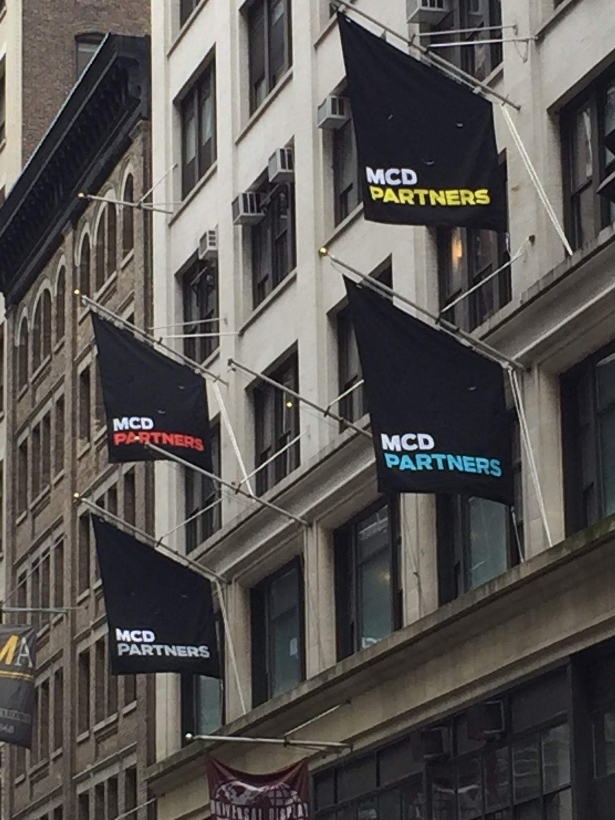National Flag and Display produces Custom Outdoor Flag Banners for the MCD Partners
