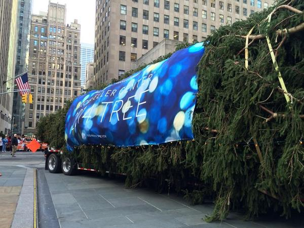National Flag and Display produces the custom outdoor banner for the 2014 Rockefeller Center Christmas Tree