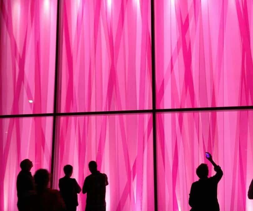 National Flag & Display produces unique pink ribbon streamers backdrop to set the mood fora special event.