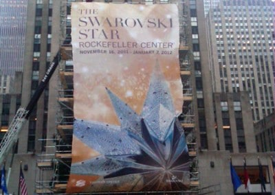 Swarovski Celebrates Raising Of Illustrious Star To The Top Of The World Famous Rockefeller Center Christmas Tree - custom banners produced by National Flag & Display (NYC)