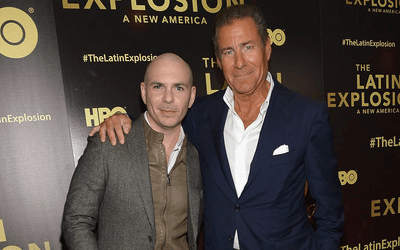 "Pit Bull and HBO CEO Richard Plepler attend ""The Latin Explosion: A New America"" screening."" - Step and Repeat Banner produced by National Flag & Display (NYC)."