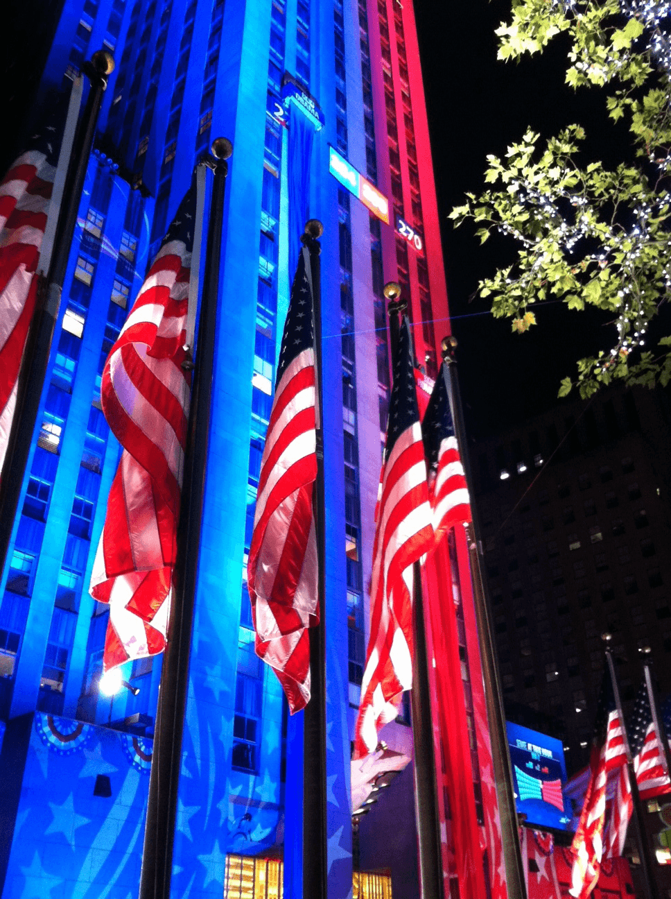 NBC's Democracy Plaza event at Rockefeller Center has National Flag & Display produce the flags and blue and red fabric that is travelling up the buildings