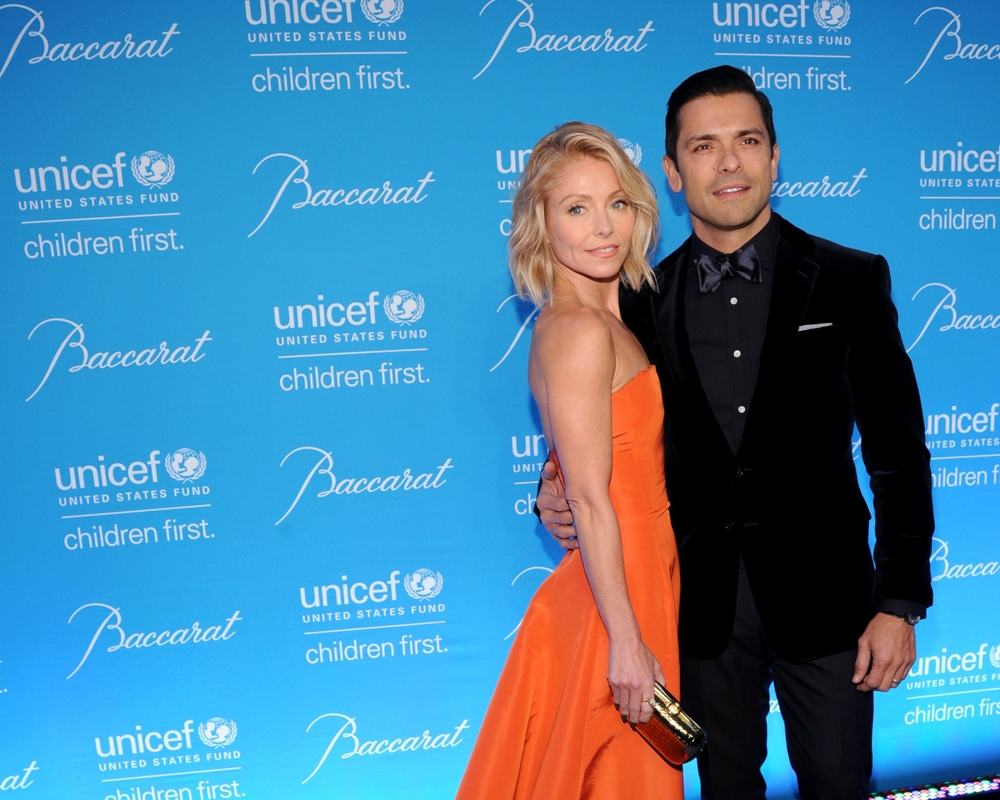 Kelly Ripa and husband Mark Consuelos at 2015 UNICEF Snowflake Ball - National Flag & Display of NYC produced the Step and Repeat Backdrops behind them.