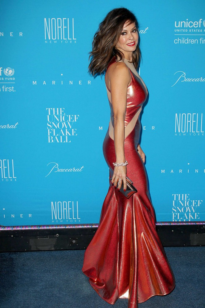 Brooke Burke at 2015 UNICEF Snowflake Ball - National Flag & Display of NYC produced the Step and Repeat Backdrops behind her.