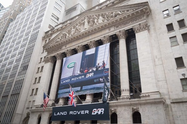 National Flag and Display produces the Custom Banners at the New York Stock Exchange, for Tata Motors Limited/Land Rover BAR. Ben Ainslie, team principal and skipper, will ring the closing bell highlighting America's Cup Boat Race in New York Harbor, May 6-8, 2016.