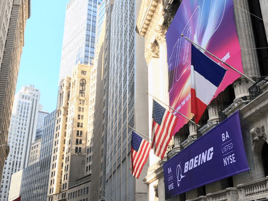 National Flag and Display produces Custom Banners at the New York Stock Exchange for the Boeing Company. The Boeing Company Celebrates their 100th Anniversary of Founding, and has become the world's largest aerospace company.
