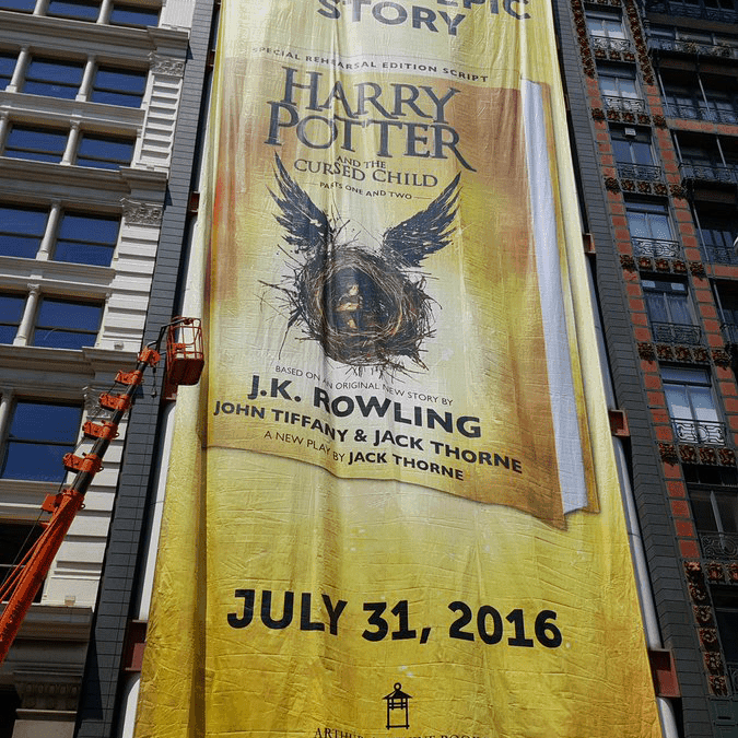 National Flag & Display produces Custom Outdoor Banner for Scholastic Corporation in connection with the launch of their latest Harry Potter book: Harry Potter and the Cursed Child. The banner measured 122' x 45' (h x w) and was produced using Ink-Jet technology on PVC Mesh