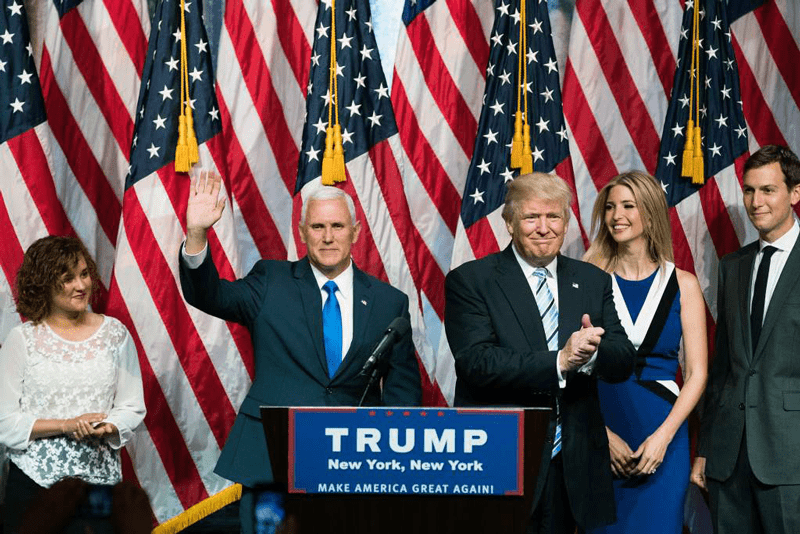 National Flag and Display provided the indoor flag presentation sets in the background at the Trump- Pence announcement ceremony for Vice President at the New York Hilton.