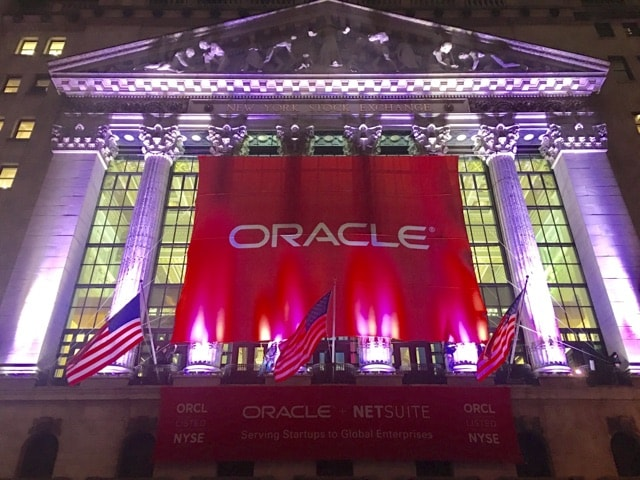 National Flag and Display produces Custom Banners at the New York Stock Exchange for the Oracle Corporation. Oracle Corporation celebrates its acquisition of NetSuite, a combination that represents a powerful new chapter in cloud innovation.