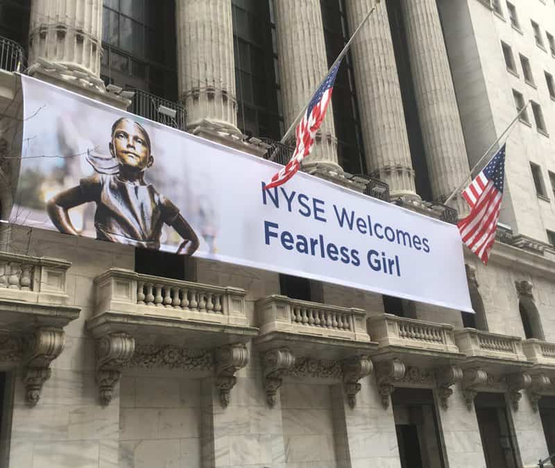 "National Flag and Display produces the Custom Banner of the ""Fearless Girl"" at the New York Stock Exchange. The bronze statue will move from its spot across from Wall Street's charging bull statue to a new location in front of the New York Stock Exchange."