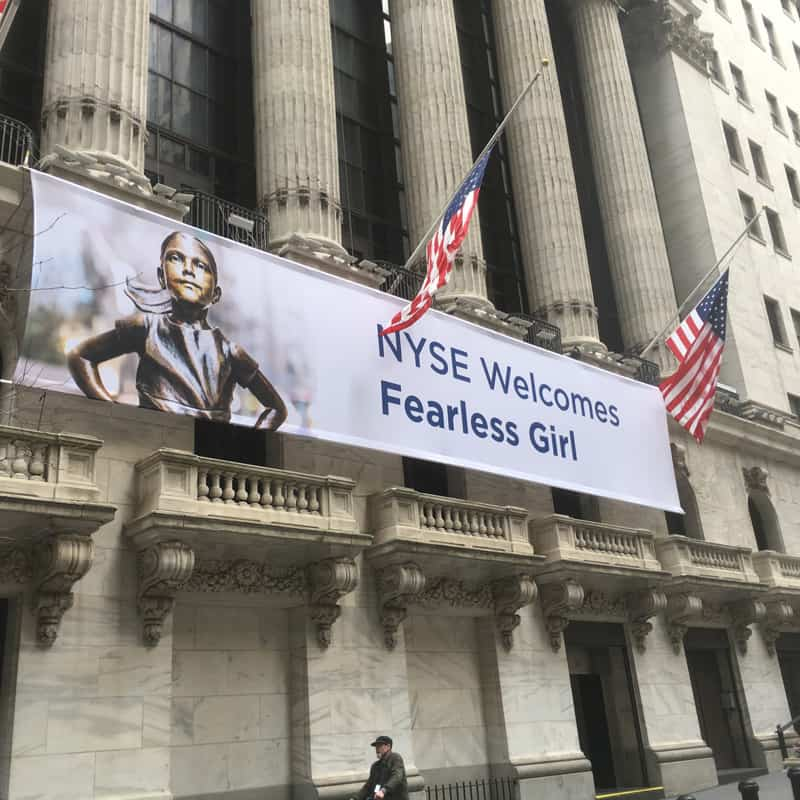 "National Flag and Display produces the Custom Banner of the ""Fearless Girl"" at the New York Stock Exchange."