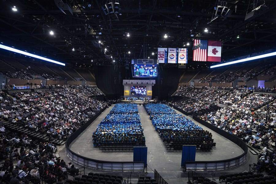 National Flag and Display produces the Custom Banners on stage for the NYIT'S (New York Institute of Technology's) 57th annual graduation ceremonies at the Nassau Veterans Memorial Coliseum.