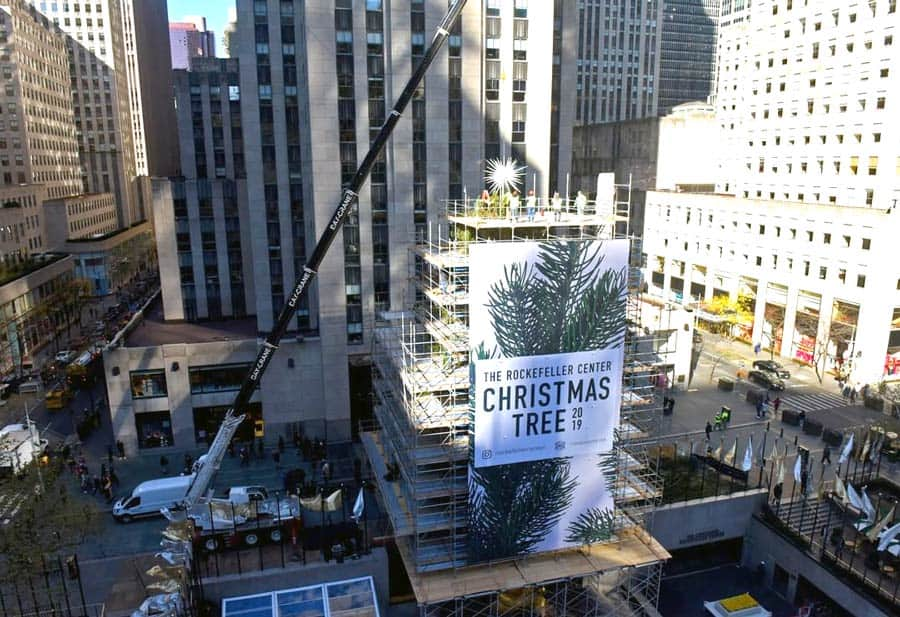National Flag and Display produces the huge Custom Banner in front of the 2019 Rockefeller Center Christmas Tree.