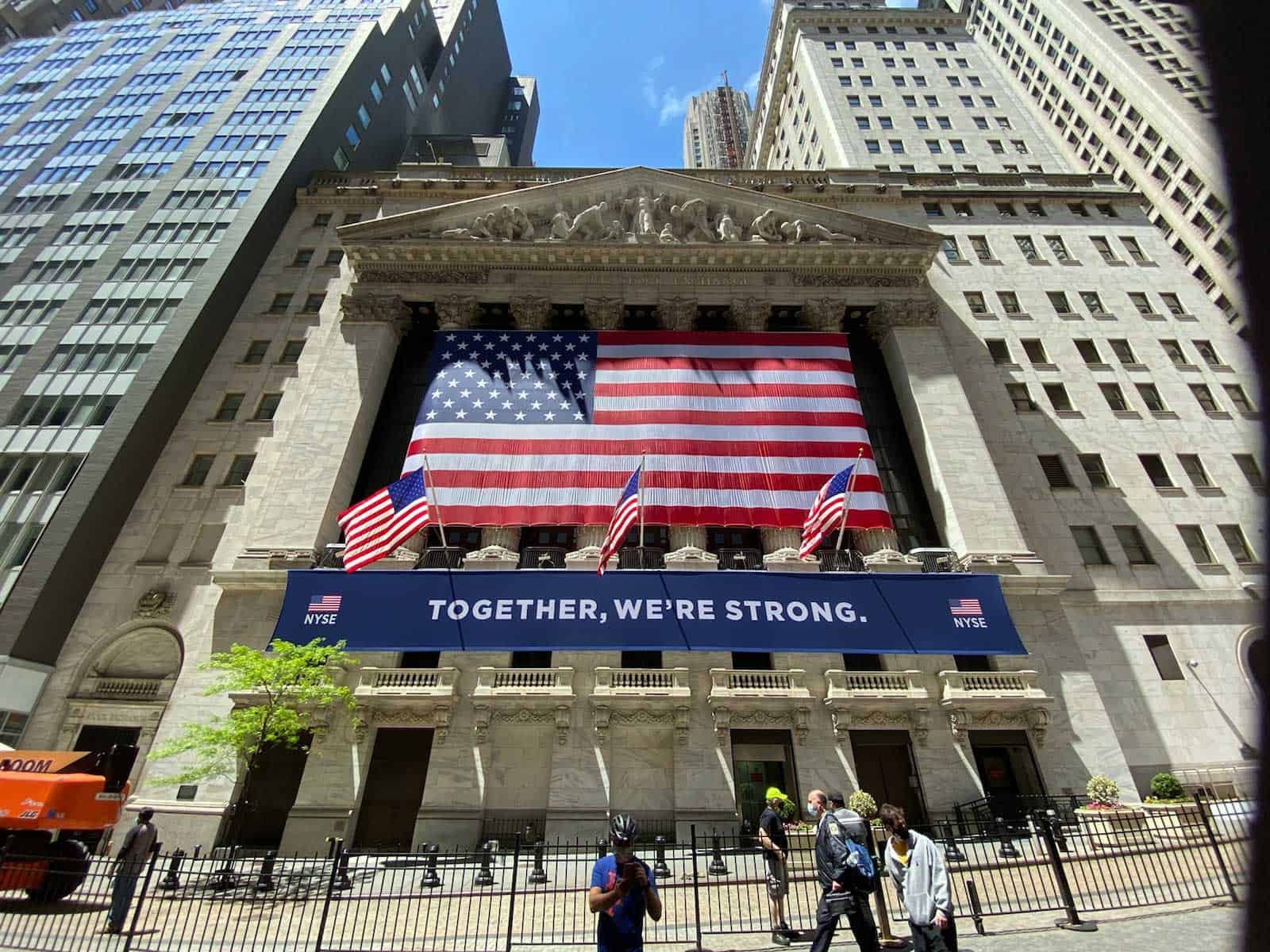 "National Flag and Display produces the American Flag and the ""Together, We're Strong"" Custom Banner at the New York Stock Exchange."