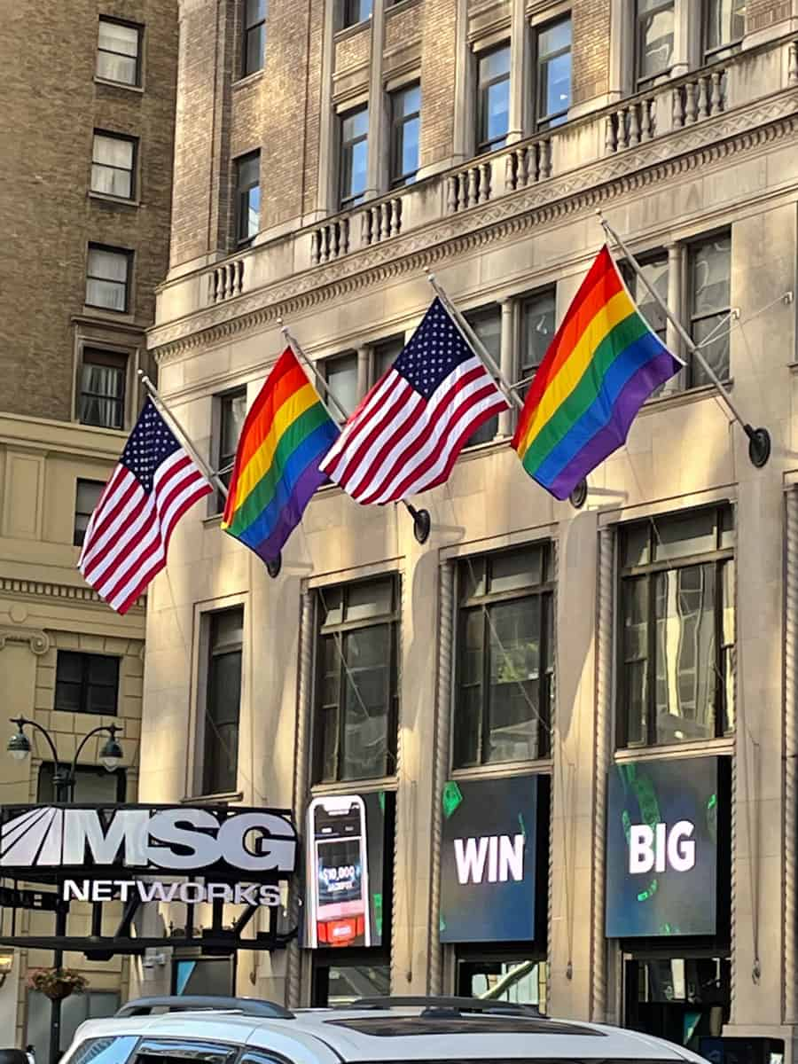 National Flag & Display produces and installs Pride flags and American flags at 11 Penn Plaza celebrating Pride in New York City.